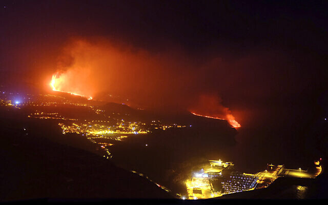 Lava from a volcano reaches the sea on the Canary island of La Palma, Spain in the early hours of Wednesday Sept. 29, 2021. (AP Photo/Daniel Roca)