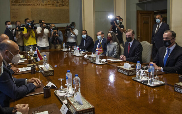 White House National Security Adviser Jake Sullivan, seated second right, meets with Egyptian Foreign Minister Sameh Shoukry and their delegations at the Foreign Ministry, in Cairo, Egypt, Wednesday, Sept. 29, 2021. (AP Photo/Nariman El-Mofty)