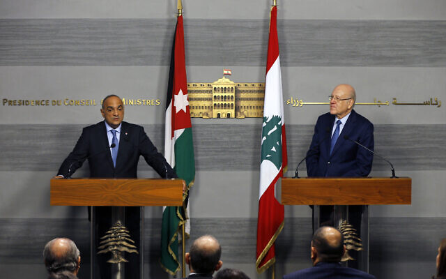 Jordanian Prime Minister Bisher Khasawneh, left, speaks during a joint press conference with his Lebanese counterpart Najib Mikati, at the Government House in downtown Beirut, Lebanon, Thursday, Sept. 30, 2021. (AP Photo/Bilal Hussein)
