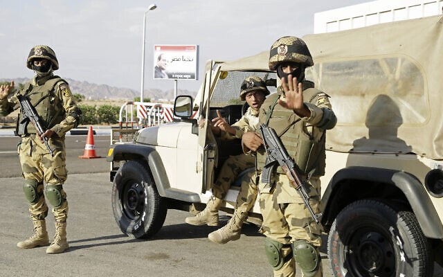 Illustrative: Egyptian soldiers guard the entrance to the Sharm el-Sheikh International Airport gesture to a photographer in south Sinai, Egypt, November 2015. (AP Photo/Thomas Hartwell, File)