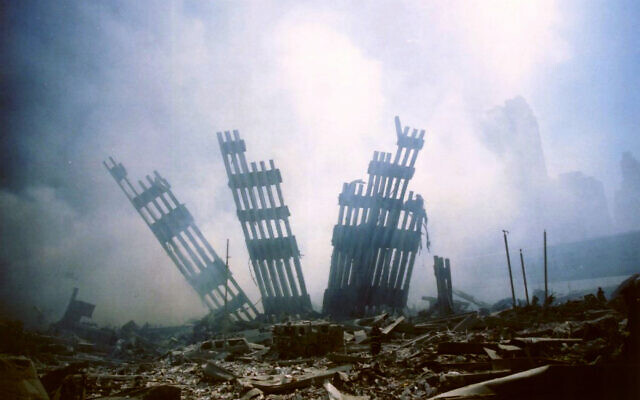 In this September 11, 2001 file photo, the remains of the World Trade Center stands amid the debris following the terrorist attack on the building in New York. (AP/Alexandre Fuchs)