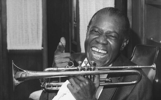 Jazz trumpeter Louis Armstrong in the upstairs den of his Corona, New York home on June 23, 1971.  (AP Photo/John Rooney)