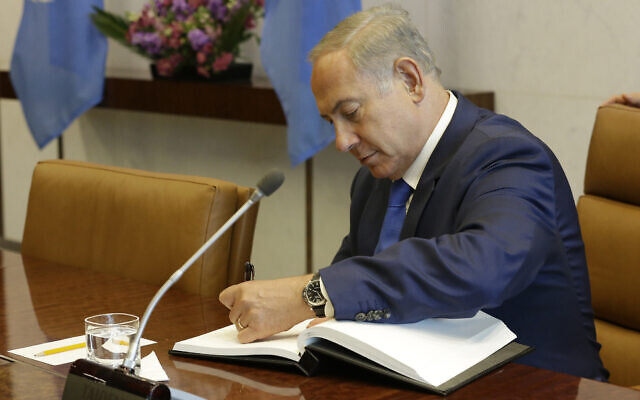 Illustrative: Then-prime minister Benjamin Netanyahu signs the United Nations guest book, October 2015, at UN Headquarters. (AP Photo/Mary Altaffer)