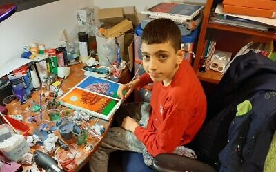 Barak Houry, 12, painting in his bedroom. (Courtesy of the Houry family)