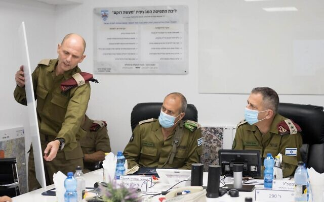 IDF Chief of Staff Aviv Kohavi, right, meets with head of the IDF Central Command Maj. Gen. Yehuda Fuchs, center, and Judea and Samaria Division commander Brig. Gen. Yaniv Alaluf during a manhunt for Palestinian fugitives who broke out of an Israeli prison earlier this month, on September 12, 2021. (Israel Defense Forces)