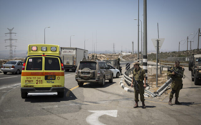Illustrative: an ambulance and IDF troops are seen on Route 443 near Beit Horon, on August 15, 2015. (Hadas Parush/Flash90)