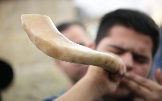 A Jewish man blows the shofar at the Rashbi gravesite in Meron, northern Israel, on September 9, 2017, prior to the Jewish holidays of Rosh Hashanah and Yom Kippur. (David Cohen/Flash90)