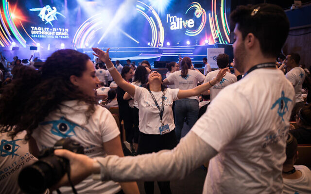 Jewish youth from across the world attend the main annual Taglit Birthright event at the International Conference Center in Jerusalem. Taglit-Birthright is a free 10-day educational trip offered to Jewish young ages 18 to 26. December 24, 2017. (Hadas Parush/FLASH90)