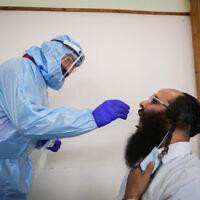 Illustrative image: A Haredi man receives a COVID-19 test (David Cohen/Flash90)