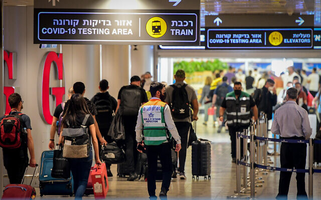 Travelers are seen at Ben Gurion Airport, on July 19, 2021. (Avshalom Sassoni/Flash90)