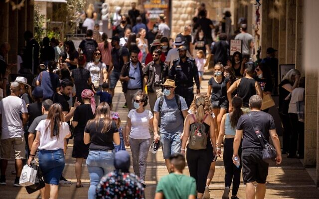 People shop at the Alrov Mamilla Avenue in Jerusalem on August 11, 2021. (Yonatan Sindel/Flash90)