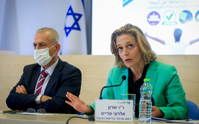Dr. Sharon Alroy-Preis, head of public health services at the Health Ministry, at a press conference in Jerusalem on August 29, 2021. On the left is Nachman Ash, director-general of the Health Minstry. (Olivier Fitoussi/Flash90)