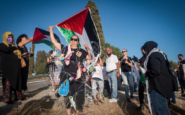 Israeli human rights activists protest calling for the release of Anhar al-Deek, 25, at the entrance to Damon prison, northern Israel, on August 29, 2021. (Roni Ofer/Flash90)