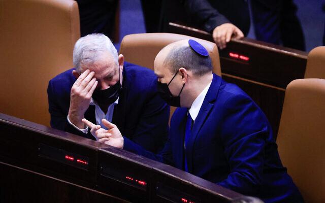 Prime Minister Naftali Bennett and Defense Minister Benny Gantz speak in the Knesset on September 2, 2021. (Olivier Fitoussi/Flash90)