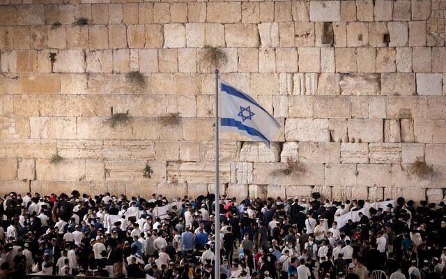 Jewish men praying for forgivness (Selichot), at the Western Wall in the Old City of Jerusalem on September 5, 2021, prior to the upcoming Jewish holiday of Rosh Hashanah (Jewish New Year). (Yonatan Sindel/Flash90)