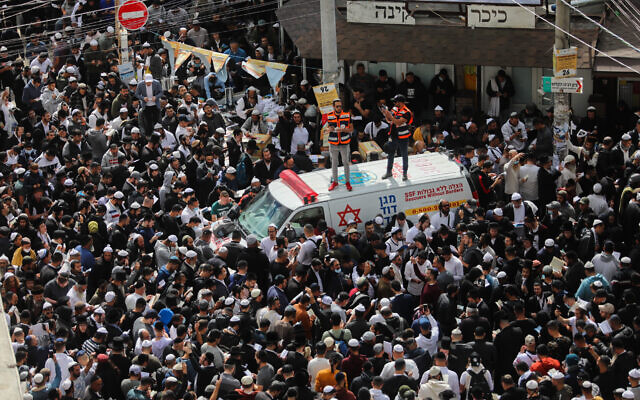 Jewish men in the street near the tomb of Rabbi Nachman of Breslov in Uman, on eve of the Jewish holiday of Rosh Hashanah, on September 6, 2021. (Flash90)