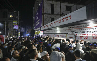 Jewish men wait outside a COVID-19 testing facility in Uman at the end of the Jewish holiday of Rosh Hashanah, on September 8, 2021. (Flash90)