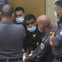 Zakaria Zubeidi, a notorious Fatah terrorist recaptured after breaking out of Gilboa Prison with five other security prisoners, arrives for a hearing at the District Court in Nazareth, on September 11, 2021. (David Cohen/Flash90)