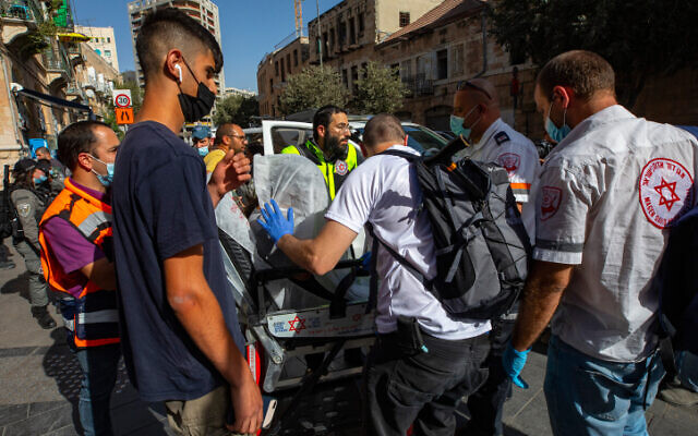 Police and rescue personnel at the scene of a terror attack at the Central Bus Station in Jerusalem. (Olivier Fitoussi/Flash90)