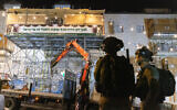 Police outside a precarious-looking sukkah in Jerusalem slated for demolition, on September 12, 2021. (Olivier Fitoussi/Flash90)