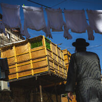 A sukkah in the ultra-Orthodox neighborhood of Mea Shearim in Jerusalem on September 19, 2021 (Olivier Fitoussi/Flash90)