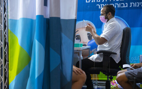 An Israeli receives the COVID-19 vaccine on September 20, 2021 in Jerusalem (Olivier Fitoussi/Flash90)