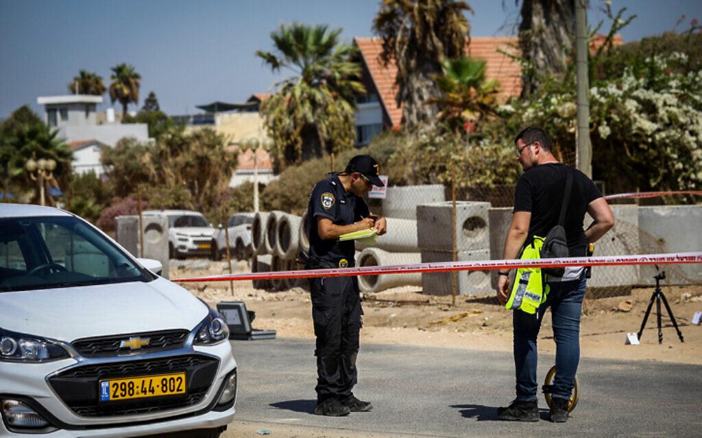 Police at the scene in Nahariya where a car ran over two policemen, killing one of them, September 21, 2021 (Alon Nadav/Flash90)