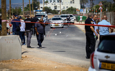 Israeli security forces at the scene in which a car ran over two police officers and killed one of them in the northern Israeli city of Nahariya, September 21, 2021 (Alon Nadav/Flash90)