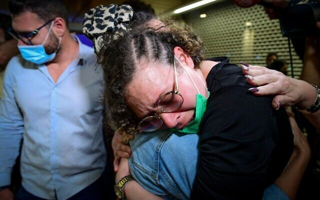 Hodaya Monsonego, an Israeli woman who was jailed in Peru, is greeted by relatives upon her arrival at Ben Gurion Airport on September 24, 2021. (Avshalom Sassoni/Flash90)