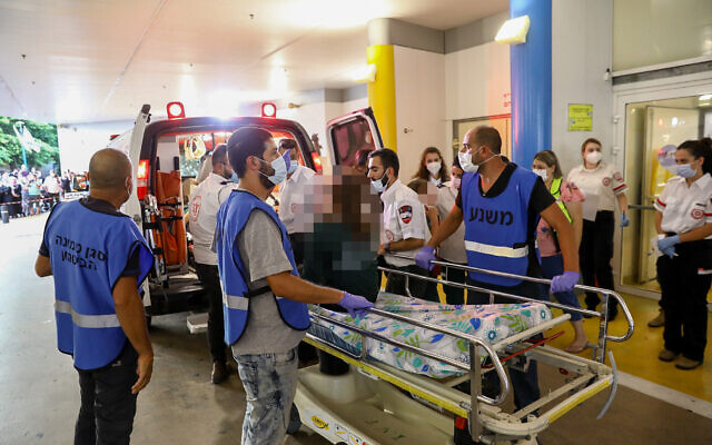 Wounded youth arrive at the Galilee Medical Center in Nahariya after being injured in a in a serious accident on Route 89 in the northern Galilee, September 29, 2021. (Alon Nadav/Flash90)