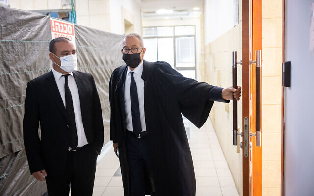 Former prime minister Benajmin Netanyahu's attorney Boaz Ben Tzur (R) and lawyer Jack Chen arrive at the Jerusalem District Court for a court hearing, September 29, 2021. (Yonatan Sindel/Flash90)
