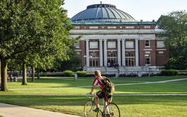 A student bikes across campus at the University of Illinois at Urbana-Champaign. (Jeffrey Greenberg/Universal Images Group via Getty Images/JTA)