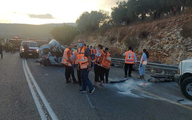 United Hatzalah volunteers work at the site of a deadly bus crash near Hurfeish on Route 89 on September 29, 2021. (United Hatzalah)