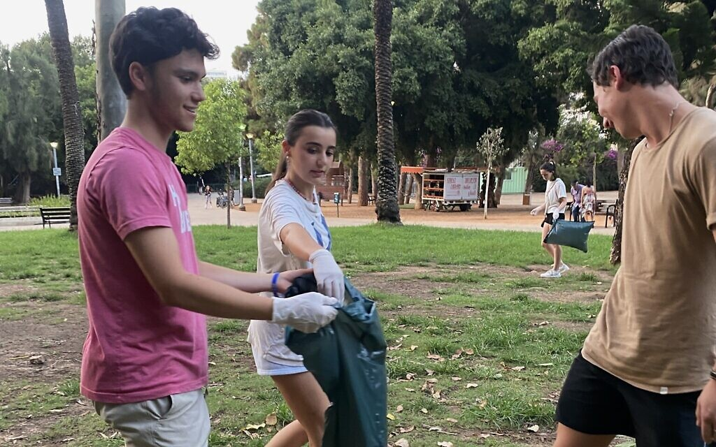 Volunteers at a Tuesdays for Trash cleanup event at a park in Tel Aviv, August 24, 2021. (Courtesy)