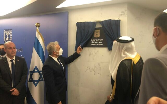 Foreign Minister Yair Lapid and Bahrain's Foreign Minister Abdullatif al Zayani open Israel's embassy in Manama, on September 30, 2021. (Shlomi Amsallem/GPO)