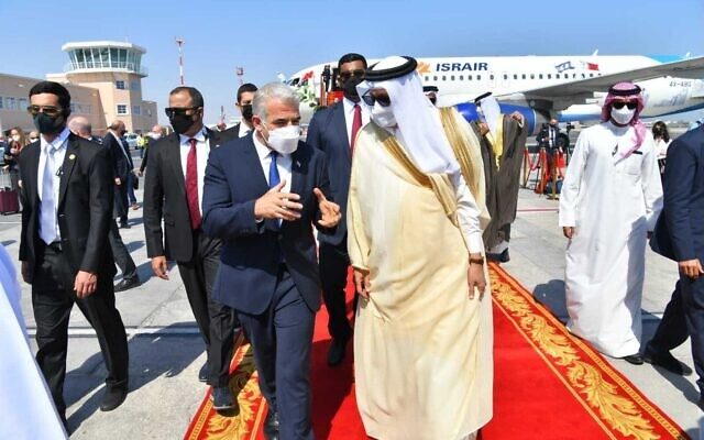 Foreign Minister Yair Lapid (left) speaks with his Bahraini counterpart Abdullatif Al Zayani at the airport in Manama, Bahrain, September 30, 2021. (Shlomi Amsalem/GPO)