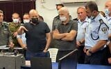Prime Minister Naftali Bennett and Public Security Minister Omer Barlev meet with police commanders about the efforts to track down six Palestinian security prisoners who escaped from prison in northern Israel, September 11, 2021. (Israel Police)