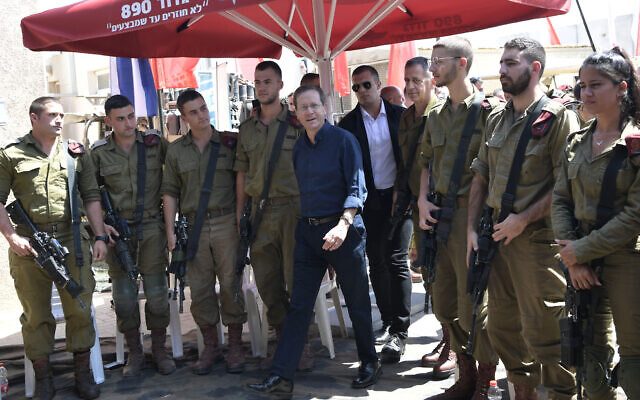 President Isaac Herzog meets with Israeli troops while touring the Gaza border in southern Israel on September 5, 2021. (Kobi Gideon/GPO)