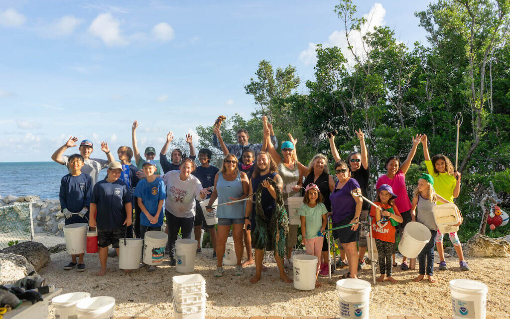 Volunteers participate in a Reverse Tashlich beach cleanup organized by the Key Largo, Florida, JCC in this undated photo. (Courtesy)