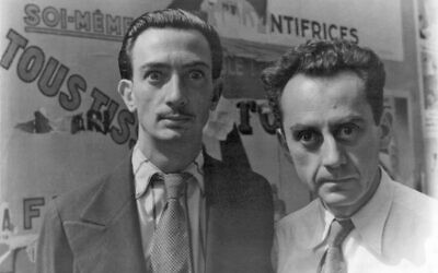 Salvador Dalí (left) and Man Ray in Paris, on June 16, 1934, making wild eyes for photographer Carl Van Vechten. (Public domain)