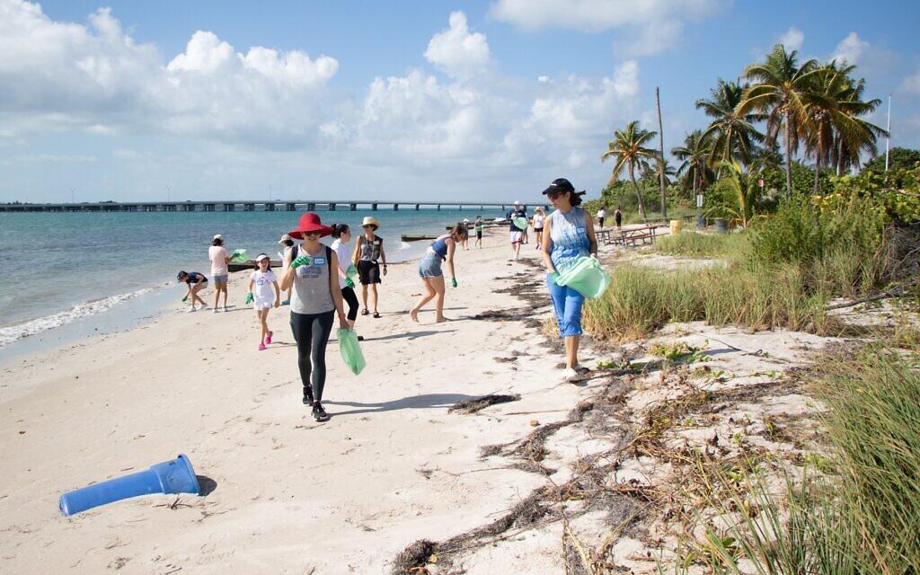 Volunteers in Miami, Florida, participate in Reverse Tashlich in this undated photo. (Courtesy)