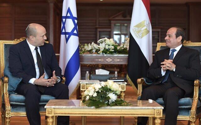 Prime Minister Naftali Bennett (L) and Egyptian President Abdel-Fattah el-Sissi meet on Monday, September 13, 2021 in Sharm el-Sheikh. (Kobi Gideon/GPO)