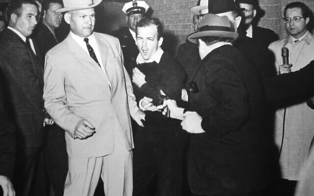 Jack Ruby shooting Lee Harvey Oswald, who is being escorted by Dallas police detective Jim Leavelle (left), November 24, 1963 (Robert H. Jackson / Wikipedia)