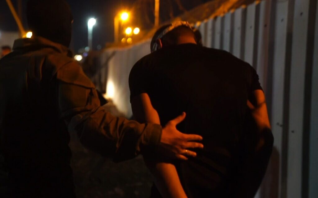 An Israeli security officer arrests a Palestinian fugitive following a nearly two-week manhunt in the northern West Bank on September 19, 2021. (Screen capture: Israel Defense Forces)