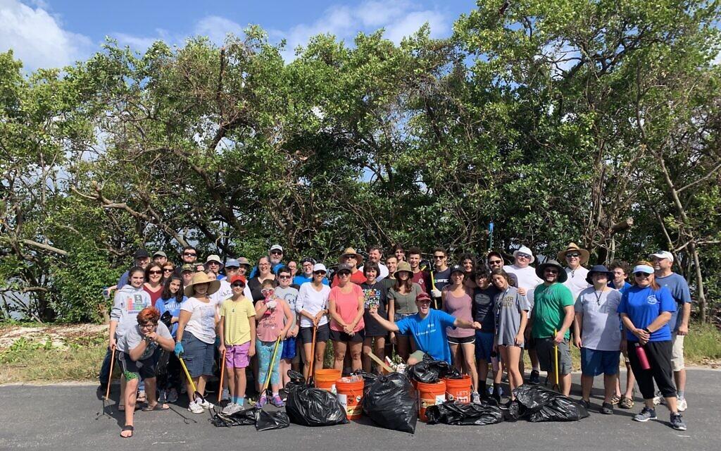 Volunteers in Tampa, Florida, participate in Reverse Tashlich in this undated photo. (Courtesy)
