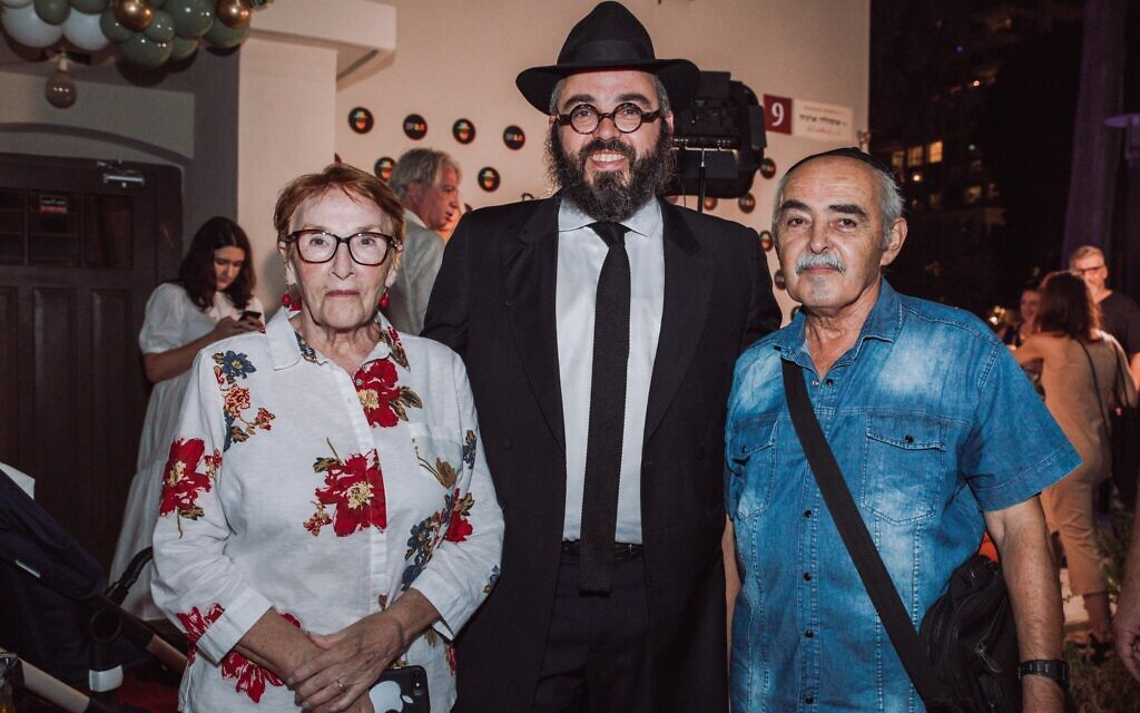 Rabbi Yosef Khersonsky, center, with his parents at the grand opening of the Jewish Point congregation's new synagogue building in Tel Aviv. It is the city's first synagogue geared specifically towards Russian speakers. (Courtesy)