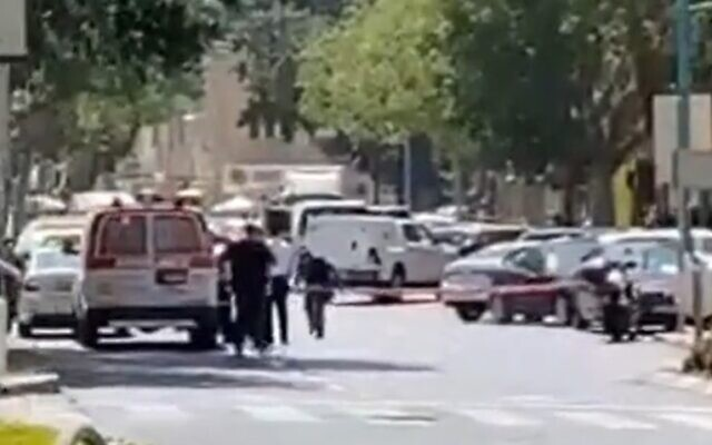 Police secure the area near a bank in Haifa where a woman threatened to detonate an explosive vest, on September 2, 2021. (Screenshot/Twitter)