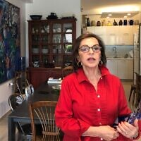 """Artist Mindy Weisel in her Jerusalem home, prior to the September 2021 launch of her memoir, """"After"""" (Jessica Steinberg/Times of Israel)"""