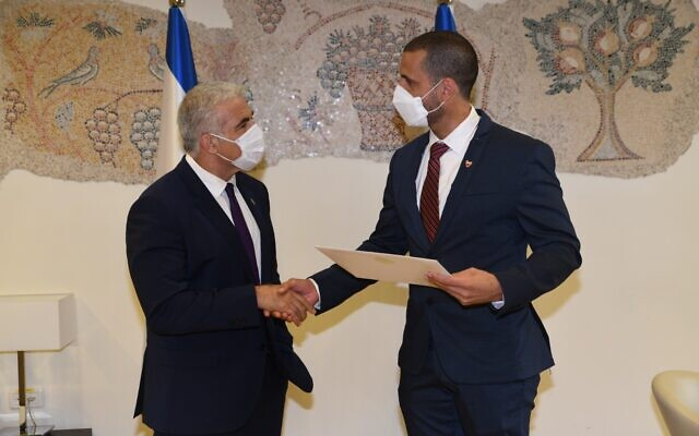 Foreign Minister Yair Lapid meets with Bahrain Ambassador to Israel Khaled Yousef al-Jalahmah in the Knesset on September 2, 2021. (Elad Gutman)