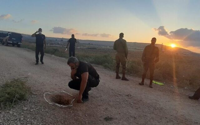 Investigators inspect the hole used by six inmates to escape Gilboa Prison, on September 6, 2021. (Israel Prison Service)
